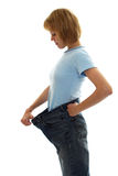 Slim girl in big size jeans Royalty Free Stock Photography