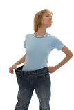 Slim girl in big size jeans Stock Photo