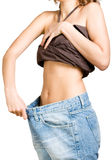 Slim girl in big size jeans Stock Image