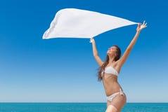 Slim girl in bikini with pareo against the sea Royalty Free Stock Photo