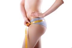 Slim girl with centimeter Stock Photo
