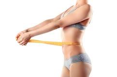 Slim girl with centimeter Stock Image