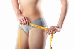 Slim girl with centimeter Royalty Free Stock Photos