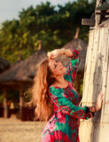 slim girl in colorful by reed wall against defocused background Stock Photography