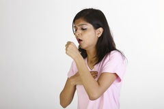 Slim girl in coughing pose