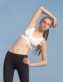 Slim girl does morning exercises Royalty Free Stock Photography