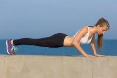 Slim girl does morning exercises Stock Photos