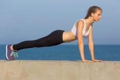Slim girl does morning exercises Stock Photo