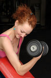 Slim girl doing biceps traning Royalty Free Stock Photos