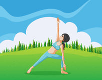 A slim girl doing yoga at the top of the hill Royalty Free Stock Images