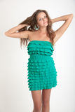Slim girl in a green dress Royalty Free Stock Photography