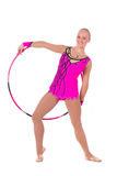 Slim girl gymnast in a costume with a hoop. Beautiful slim girl gymnast in a costume with a hoop over white background royalty free stock photo