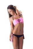 Slim girl with healthy skin posing in pink bikini Stock Photos