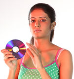 Slim girl holding cd Stock Photos