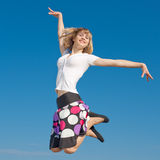 Slim girl jumping Royalty Free Stock Photos