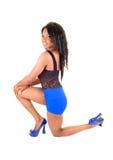 Slim girl kneeling. Stock Photography