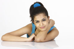 Slim girl lying on the table Stock Images