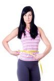 Slim girl measuring her waist Stock Photos
