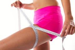 Slim girl measuring her waist. Stock Photography