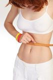 Slim girl measuring waist Royalty Free Stock Images
