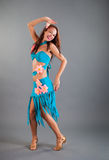 Slim Girl in Open Blue Dance Costume Poses Smiles Royalty Free Stock Photos