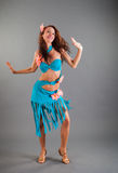 Slim Girl in Open Blue Dance Costume Poses Smiles Royalty Free Stock Photography
