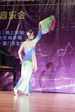 Slim girl perform folding fan dance Stock Photo