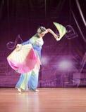 The slim girl perform folding fan dance Stock Photo