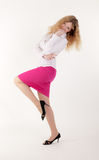 The slim girl in a pink skirt Royalty Free Stock Photo