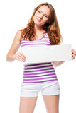 Slim girl with red hair holds a poster Stock Images