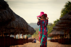 slim girl in red hat looks down among defocused umbrellas Royalty Free Stock Photography