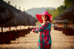 slim girl in red hat looks down among defocused umbrellas Stock Photography