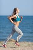 Slim girl runs Royalty Free Stock Images