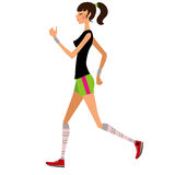 Slim girl runs. Slim young pretty girl in shorts  jogging Stock Photography