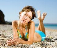 Slim girl at the sea Stock Photos