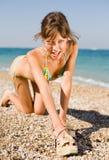 Slim girl at the sea Stock Photo