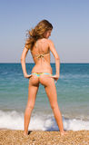 Slim girl at the sea Royalty Free Stock Image
