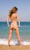 Slim girl at the sea Royalty Free Stock Image