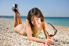 Slim girl on seashore Stock Photography