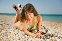 Slim girl on seashore Royalty Free Stock Photography