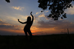 Slim girl showing various poses and dancing in a field outdoors stock photos
