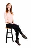 Slim girl sitting. Royalty Free Stock Image