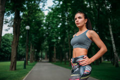 Slim girl in sportswear, outdoor fitness training Stock Photography
