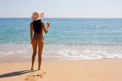 Slim girl standing by sea Royalty Free Stock Images