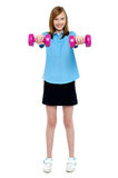 Slim girl striking a pose with dumbbells Stock Image