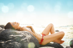 Slim girl sunbathing Stock Photos