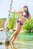Slim girl in swimsuit posing Royalty Free Stock Photos