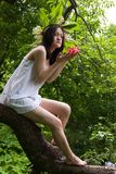 Slim girl on tree at nature Stock Photos