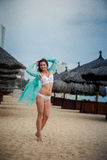 Slim girl in underwear thrown open transparent gown on beach Stock Images