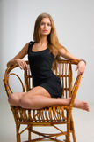 Slim girl on vintage chair Royalty Free Stock Image
